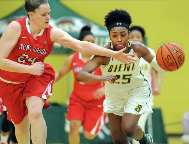 Siena's Tehresa Coles, right, drives up court as Stony Brook's Elizabeth Manner defends during the Women's Basketball Invitational on Thursday, March 19, 2015, at Siena College in Loudonville, N.Y. (Cindy Schultz / Times Union) Photo: Cindy Schultz / 10031106A