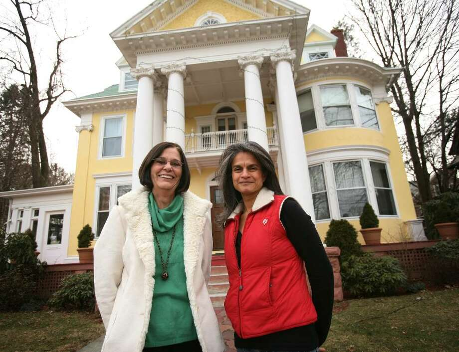 Joy Kiss, left, CEO and executive director for Homes for the Brave with Shalini Madaras, president of the Kick for Nick Foundation, is hoping to operate a transitional home for women veterans at 893 Clinton Avenue in Bridgeport. Photo: Brian A. Pounds / Connecticut Post