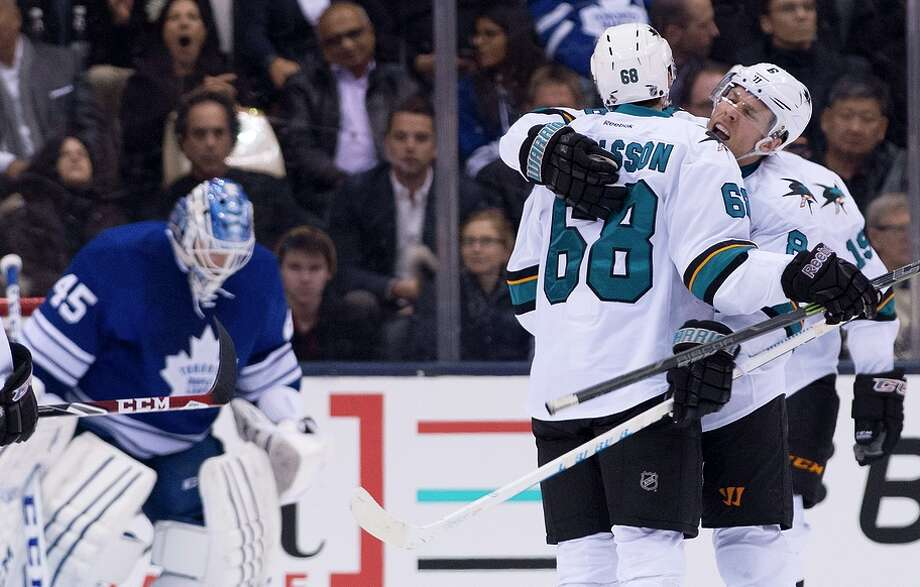 Melker Karlsson and Joe Pavelski (right) celebrate in front of goalie Jonathan Bernier after Karlsson's second-period goal. Photo: Nathan Denette / Associated Press / The Canadian Press