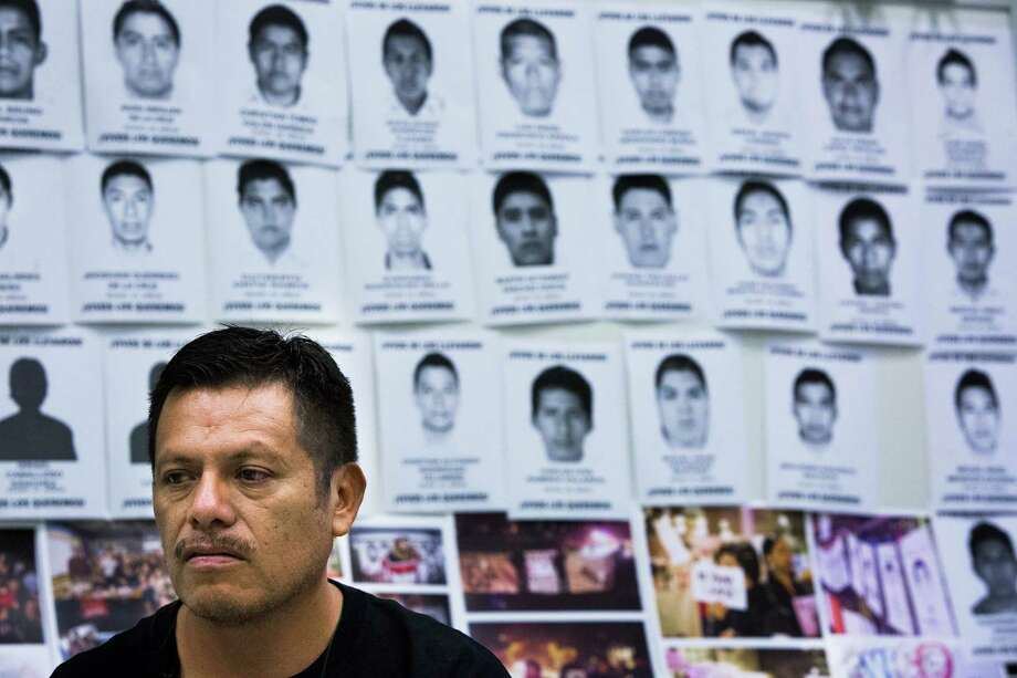 Clemente Rodriguez Moreno stands in front of the photos of some of the 43 students that went missing Sept. 26, 2014 in Iguala, Guerrero, Mexico. One of the student is Rodriguez Moreno's son Christian Alfonso Rodriguez. Rodriguez Moreno is part of a tour that will be visiting some of the biggest cities in the United States seeking for support to pressure the Mexican government to investigate case.  Thursday, March 19, 2015, in Houston. Photo: Marie D. De Jesus, Houston Chronicle / © 2015 Houston Chronicle
