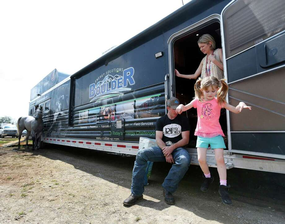 "Cowboy Josh Peek with his wife, Kori, and daughter Emry, 5, at the ""cowboy village"" where contestants live during the Houston Livestock Show and Rodeo, Thursday, March 19, 2015, in Houston. Photo: Karen Warren, Houston Chronicle / © 2015 Houston Chronicle"