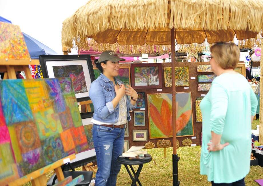 Fun and creativity went hand in hand Satuday at Art in the Park in downtown Orange. The annual event, held at the Riverfront Boardwalk and Pavilion, featured arts and crafts booths, live music, food, children's activities and more. Photo: Beaumont Enterprise
