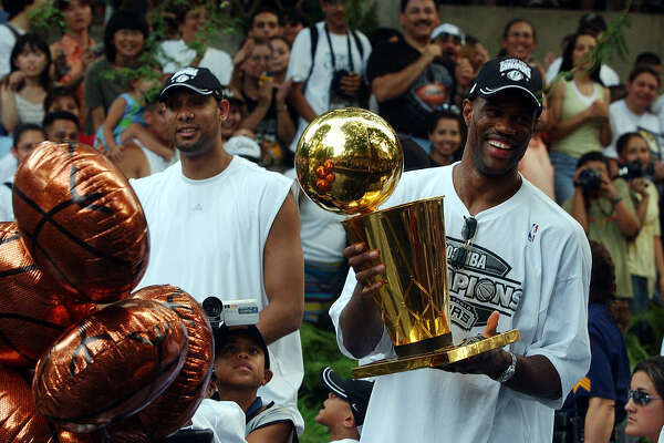 San Antonio Spurs Tim Duncan and David Robinson  ride a barge with the 2003 NBA Champhionship trophy during the Spurs Championship river parade on Wednesday, June 18, 2003.