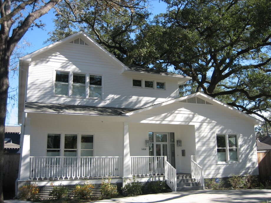 This modern Craftsman home at 1414 Ashland is known to many in the Houston Heights as the Heron House, so named because each spring the three large live oak trees the home is built around attract nesting pairs of yellow-crested night herons. Photo: Courtesy Of Denise Martin
