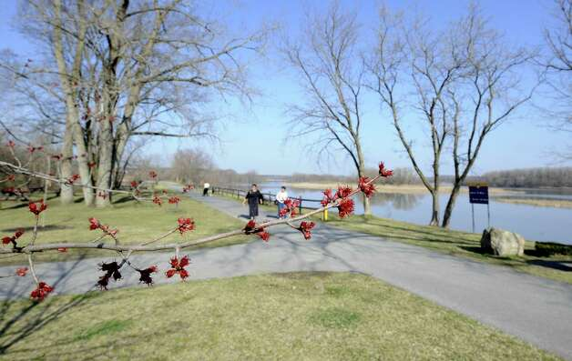 The buds are opening rapidly on the trees near the bike path at Lions Park in Niskayuna, N.Y. March 20, 2012.  The extended warm days we are causing the buds to open much quicker in the region.  (Skip Dickstein/Times Union) Photo: Skip Dickstein, Albany Times Union / 00016888A