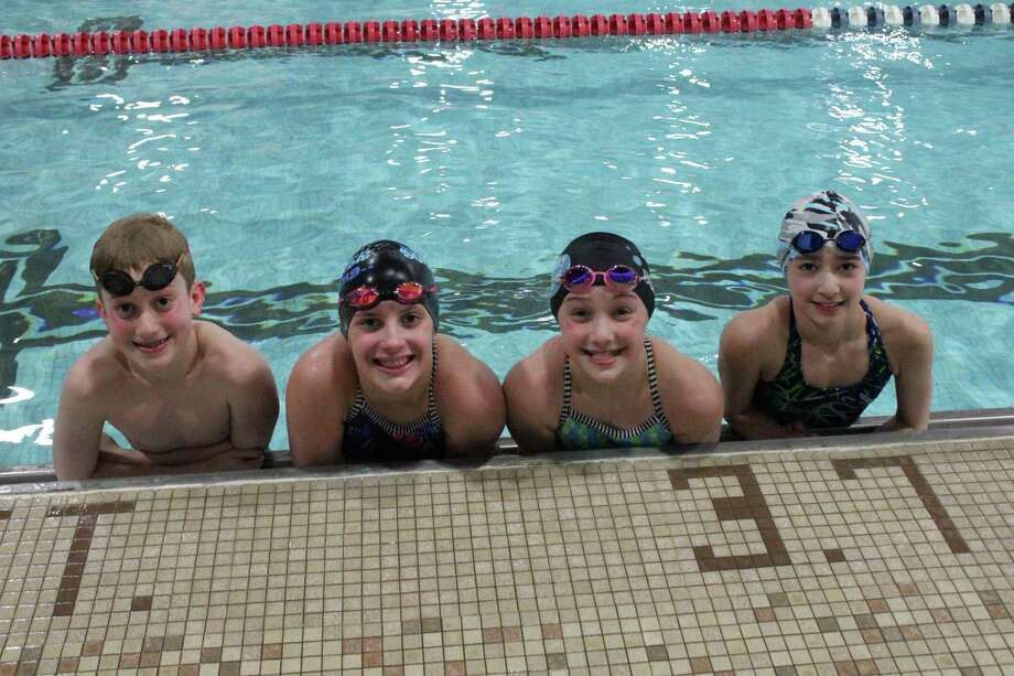 The New Canaan YMCA Caimans will send five team members to represent Connecticut in the Eastern Zone SC Age Group Championships. From left are, Bennett Ehret, Catherine Steinberg, Julia Cassone and Kaylana Couture. Not pictured is Michael Kotlyar. Photo: Contributed Photo / New Canaan News