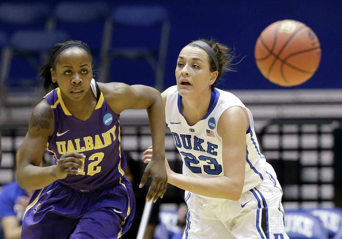 Albany's Imani Tate and Duke's Rebecca Greenwell (23) chase a loose ball during the first half of a women's college basketball game in the first round of the NCAA tournament in Durham, N.C., Friday, March 20, 2015. (AP Photo/Gerry Broome) ORG XMIT: MER2015032012482765