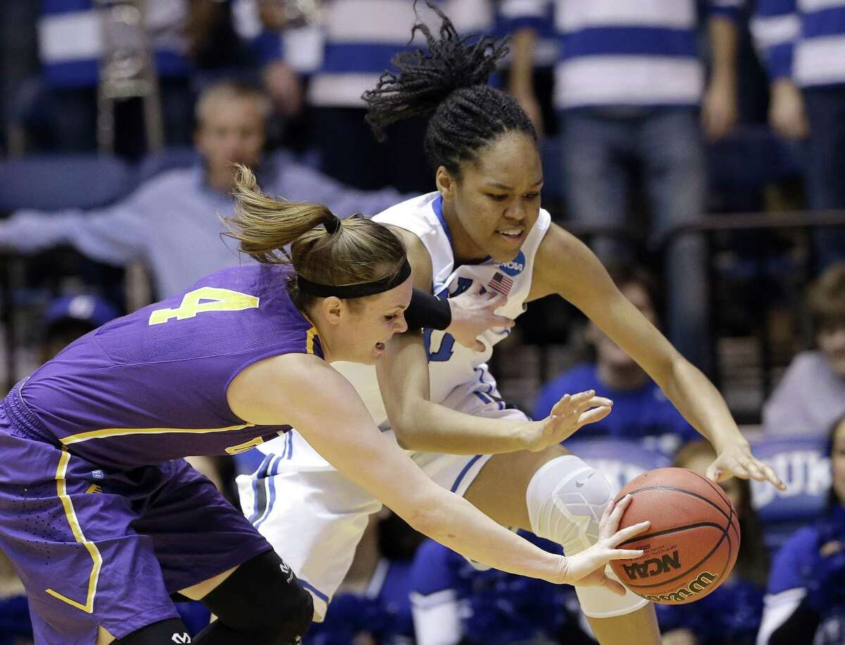 Albany's Sarah Royals (4) and Duke's Azura Stevens reach for the ball during the first half of a women's college basketball game in the first round of the NCAA tournament in Durham, N.C., Friday, March 20, 2015. (AP Photo/Gerry Broome) ORG XMIT: MER2015032012564078