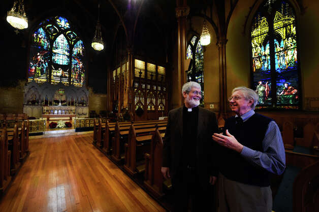 The Rev. Michael Gorchov, Rector of St. Paul's Episcopal Church, left, speaks with Church Historian Ned Pratt as they kicked off their fund raising effort to save the to make repairs to the historic site during a press conference Monday morning Dec. 29, 2014 in Troy, N.Y.    (Skip Dickstein/Times Union) Photo: SKIP DICKSTEIN, ALBANY TIMES UNION / 00030015A