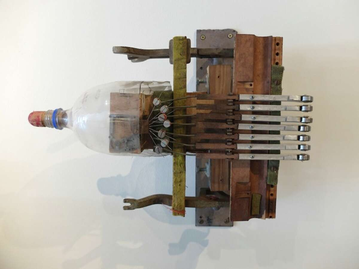 """One of Patrick Renner's """"Telephone Pole Pianos,"""" from a set of three; on view in """"Cabinet of Curiosities"""" at Gallery Jatad through April 25."""