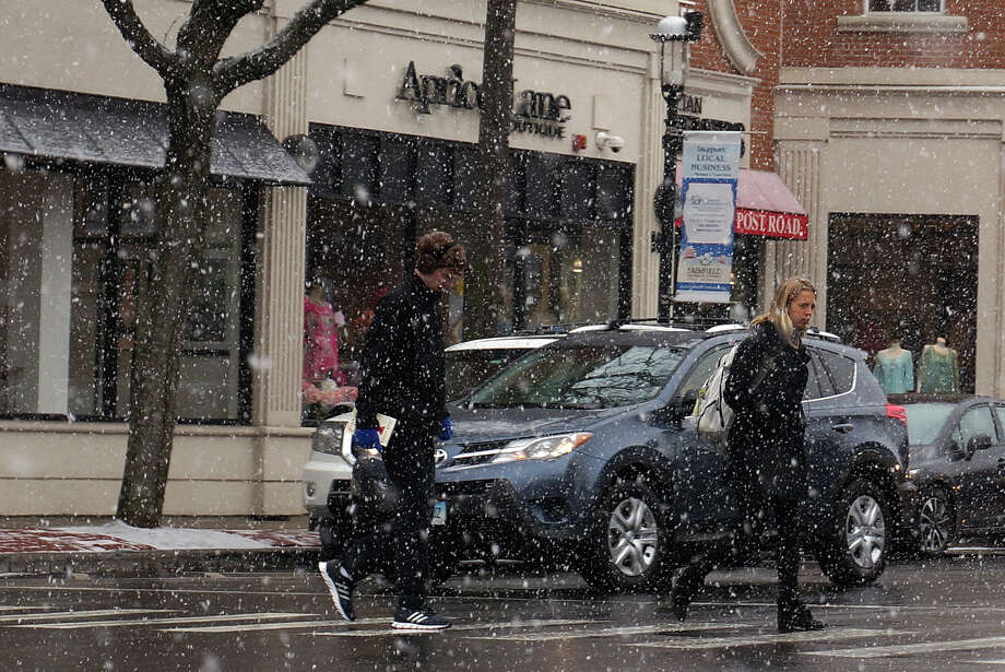 Snow started falling downtown early Friday -- the first day of spring. Up to six inches of snow is possible, according to the National Weather Service. Photo: Genevieve Reilly / Fairfield Citizen