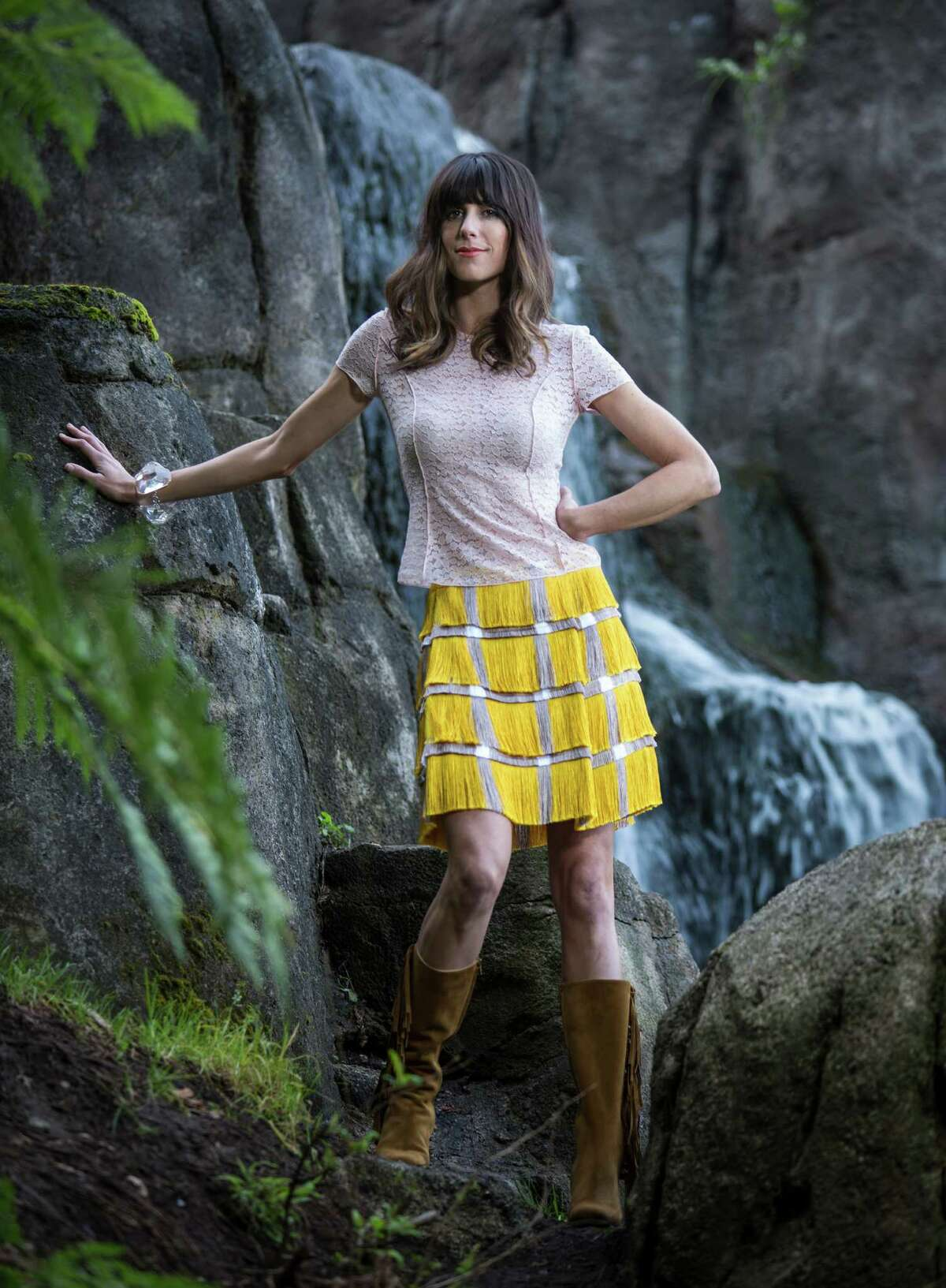 Back to nature: Nicki Bluhm wears a Nina Ricci pink lace top, Nina Ricci, $990, Barneys; Marco de Vincenzo fringe skirt, $1,450, Neiman Marcus; Saint Laurent fringe-trimmed suede knee-high boots, $1,695, Saks Fifth Avenue. Styling: Dorsey Blunt; hair & makeup: Katie Nash; styling assistant: Shayla Dopp; photo assistants: Stephen Lam, Amy Osborne, Terray Sylvester