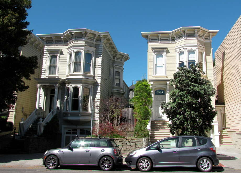 These two houses on the 2500 block of Clay Street, just east of Alta Plaza, were built as part of a housing tract in 1874 -- and aren't quite as substantial as they appear from the front, since the cornice extends several feet above the roof. Photo: John King / The Chronicle / ONLINE_YES