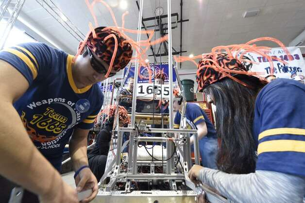 A team from Shenendehowa High School prepares for the FIRST Robotics Competition at RPI.  (Skip Dickstein / Times Union)