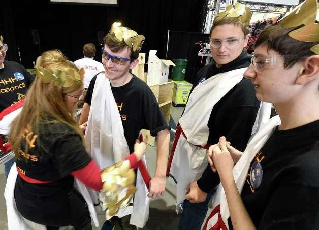 The robotics team from Dix Hills High School prepares their costumes for competition in the FIRST Robotics Competition Friday morning March 20, 2015,  at Rensselaer Polytechnic Institute in Troy, N.Y.   They call themselves the Geekgods.  (Skip Dickstein/Times Union) Photo: SKIP DICKSTEIN / 00031036A