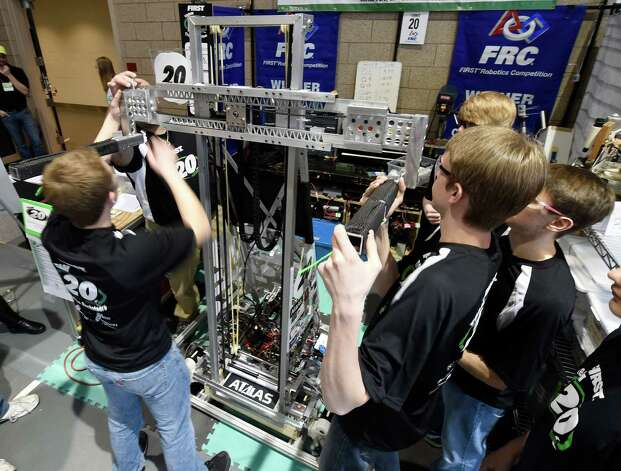 The robotics team from Shenedehowa High School prepares their robot for competition in the FIRST Robotics Competition Friday morning March 20, 2015,  at Rensselaer Polytechnic Institute in Troy, N.Y.        (Skip Dickstein/Times Union) Photo: SKIP DICKSTEIN / 00031036A