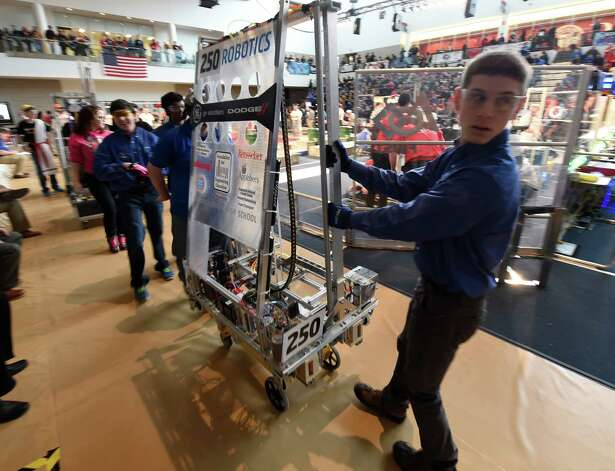 The robotics team from Colonie High School leaves the playing field after their competition in the FIRST Robotics Competition Friday morning March 20, 2015,  at Rensselaer Polytechnic Institute in Troy, N.Y.        (Skip Dickstein/Times Union) Photo: SKIP DICKSTEIN / 00031036A