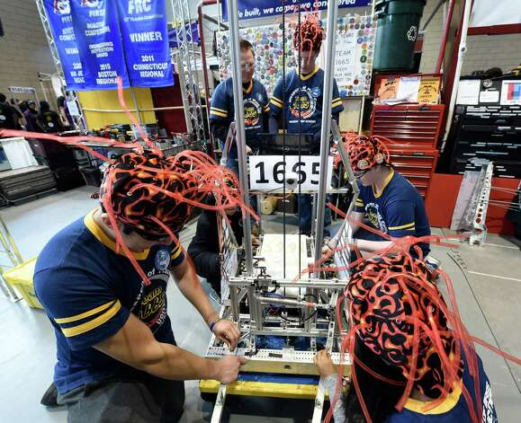 The robotics team from Hudson High School prepares their robot for competition in the FIRST Robotics Competition Friday morning March 20, 2015,  at Rensselaer Polytechnic Institute in Troy, N.Y.        (Skip Dickstein/Times Union) Photo: SKIP DICKSTEIN / 00031036A