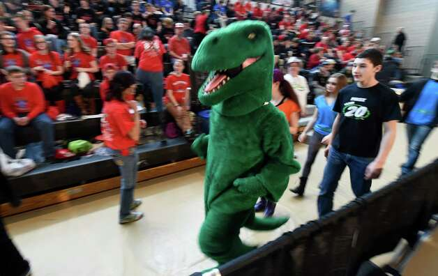 An alligator mascot runs around at the FIRST Robotics Competition Friday morning March 20, 2015,  at Rensselaer Polytechnic Institute in Troy, N.Y.        (Skip Dickstein/Times Union) Photo: SKIP DICKSTEIN / 00031036A