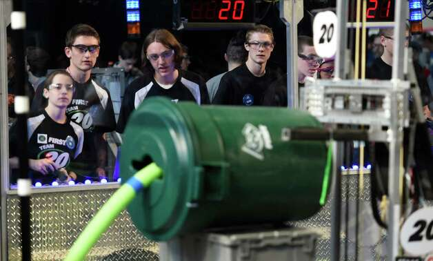 The robotics team from Shenedehowa High School concentrate on their robot during the heat of competition in the FIRST Robotics Competition Friday morning March 20, 2015,  at Rensselaer Polytechnic Institute in Troy, N.Y.        (Skip Dickstein/Times Union) Photo: SKIP DICKSTEIN / 00031036A