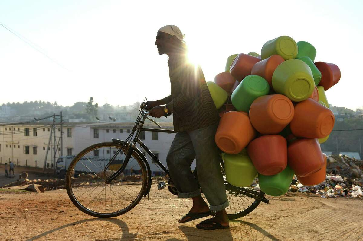 A vendor carrys colourful plastic water pots on his bicycle to sell to households in Bangalore. A new UN report warns of an urgent need to manage the world's water more sustainably and highlight the problem of groundwater over-extraction, particularly in India and China.