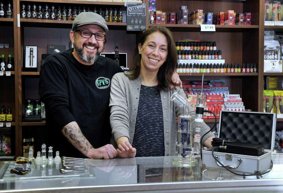 Matt and Jen Osmun, owners of Grassy Plain Vape and Smoke pose in their Bethel, Conn. location on Friday, March 20, 2015. Photo: Carol Kaliff / The News-Times