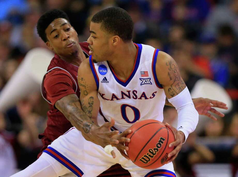 #2 Kansas 75, #15 New Mexico State 56CenturyLink Center, Omaha, Neb.Top performer: Frank Mason (Kansas) – 17 points, 9 rebounds, 4 assists, 2 stealsThere wasn't much doubt about this matchup, as the Kansas opened a comfortable lead and never let the New Mexico State Aggies. The Jayhawks shot 54 percent from the field and made 70 percent of their 3-point attempts, while the Aggies shot just 36 percent on the floor. Photo: Nati Harnik, Nati Harnik/AP Photo / AP