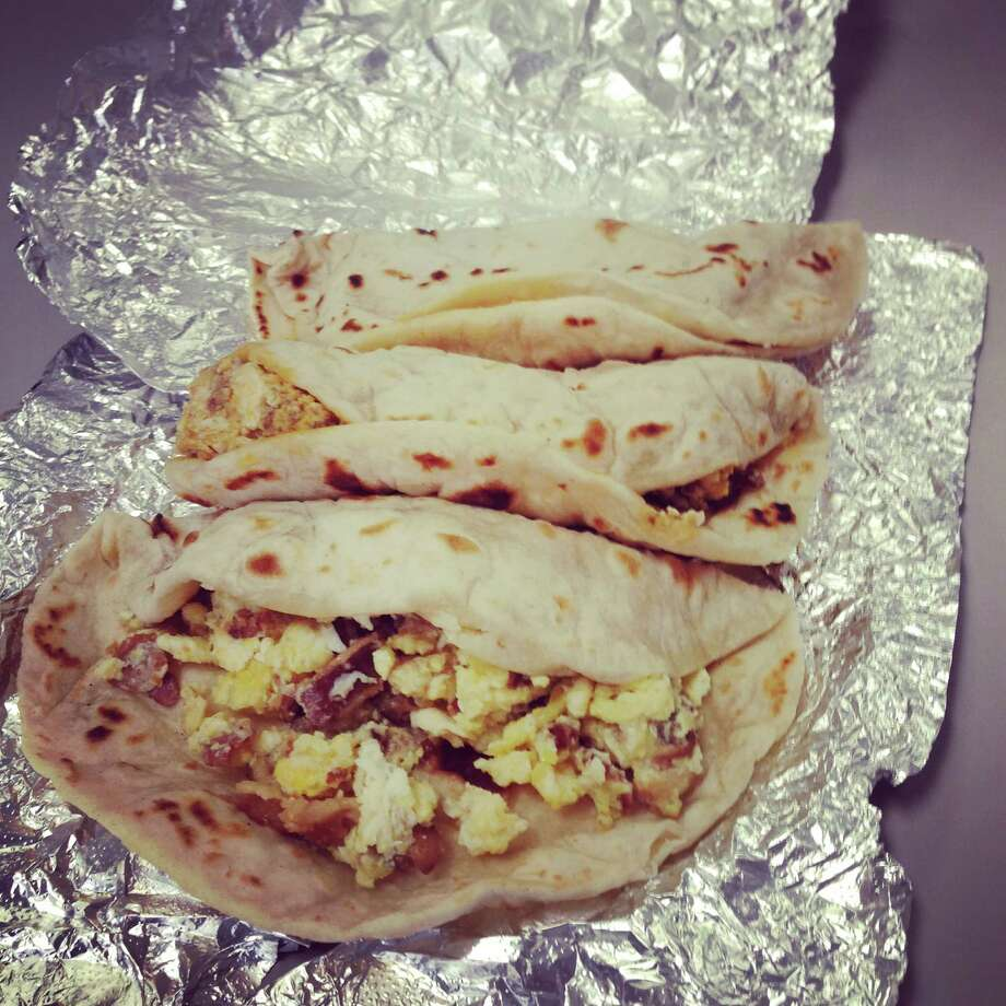 1. We can foil the foil San Antonian breakfast taco lovers don't have to unwrap the aluminum foil to know what kind of taco lies beneath. All we have to do is give it a little feel and squeeze to know if it's a bacon and egg or bean and cheese. Slighty squishy? That's a bacon and egg. Very squishy? You've got yourself a bean and cheese.  Photo: Edmund Tijerina / San Antonio Express-News
