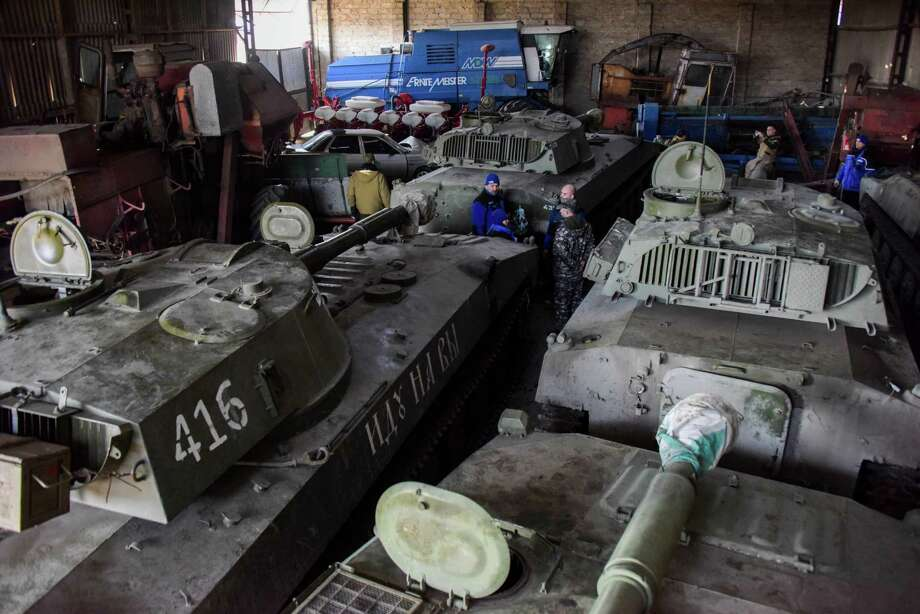 Monitors of the Organization for Security and Co-operation in Europe inspect a pro-Russian rebels' storage of artillery in the town of Novoamvrosiivske. Photo: Mstyslav Chernov / Associated Press / AP