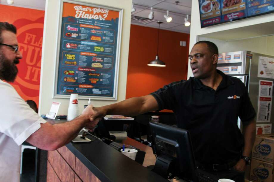 Raymond Patrick has worked in the U.S. Army for more than 25 years. He's now the owner of San Antonio's fourth Wing Zone location. Photo: Photo By Tyler White/SAEN