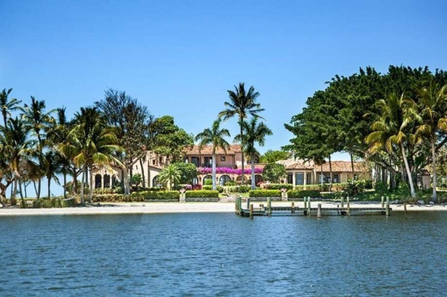 Photos from Zillow.com show the Little Bokeelia Island that is on the market for $24.5 million. The island is located at the tip of Pine Island off Florida's east coast. The island spans 104 acres, and the mansion atop has four bedrooms with a pool, attached guest house, tennis court and garage for golf carts. Photo: Zillow
