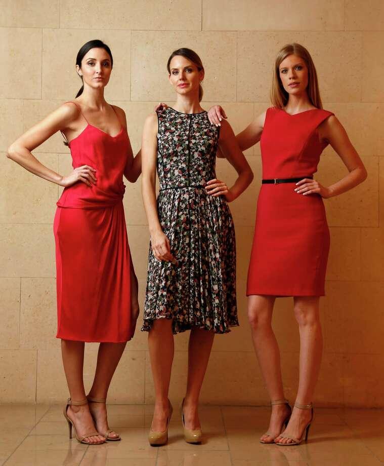 Page  Parkes  models Katelynn Denney,  Diana Hare and Alyssa Pasek wear dresses by Jason Wu at Neiman Marcus. Photo: Karen Warren, Staff / © 2015 Houston Chronicle