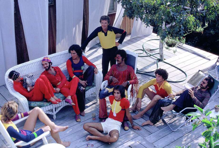 Stephen Burrows, center in chair, partied with friends in Fire Island, N.Y. Burrows' fashion was resolutely modern and famed for colorful, near-sheer jersey dresses. It's clear from Robins Givhan's descriptions that his Versailles show was the real revolution. Photo: Charles Tracy
