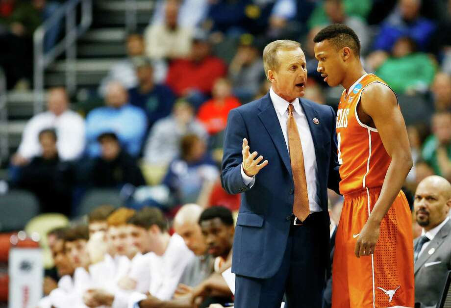 PITTSBURGH, PA - MARCH 19:  Head coach Rick Barnes of the Texas Longhorns talks to Demarcus Holland #2 in the first half against the Butler Bulldogs during the second round of the 2015 NCAA Men's Basketball Tournament at Consol Energy Center on March 19, 2015 in Pittsburgh, Pennsylvania.  (Photo by Jared Wickerham/Getty Images) Photo: Jared Wickerham, Stringer / Getty Images / 2015 Getty Images