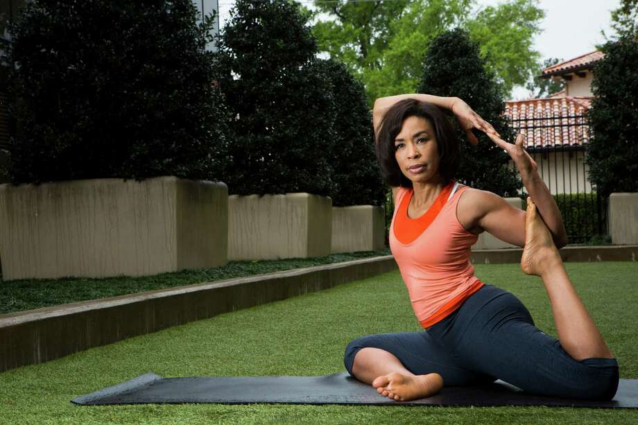 At the Houstonian Hotel Club & Spa, Channel 13 KTRK anchor Gina Gaston shows the half pigeon pose. She has been keeping her body strong with yoga since 1999.  ( Marie D. De Jesus / Houston Chronicle ) Photo: Marie D. De Jesus, Staff / © 2015 Houston Chronicle