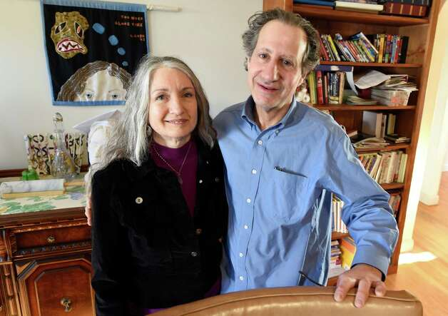 Cheryl Gorn, left, and Charlie Silberman at their home Thursday morning, March 19, 2015, in Latham, N.Y. The duo are raising funds to become legal guardians of an undocumented immigrant.  (Skip Dickstein/Times Union) Photo: SKIP DICKSTEIN / 10031099A