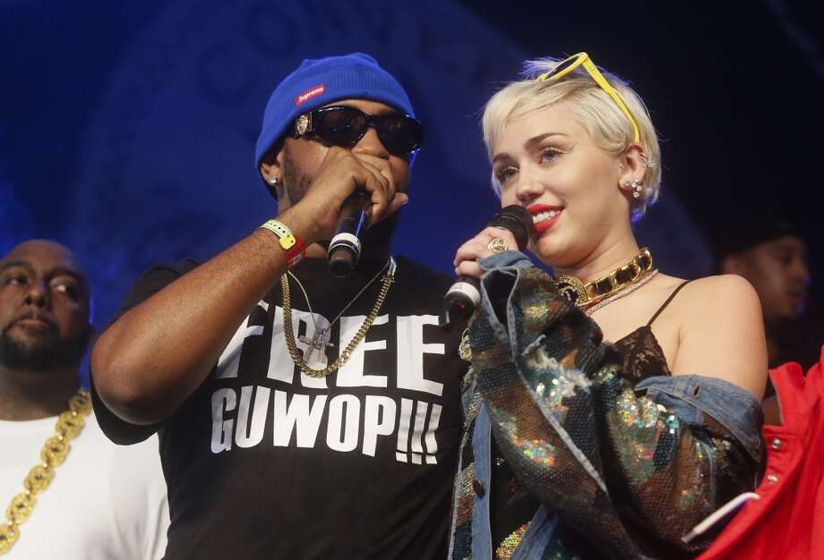 Miley Cyrus, right, joins Mike Will Made It onstage at the Fader Fort Presented by Converse during the SXSW Music Festival on Thursday, March 19, 2015 in Austin, Texas. Photo: Jack Plunkett, Associated Press