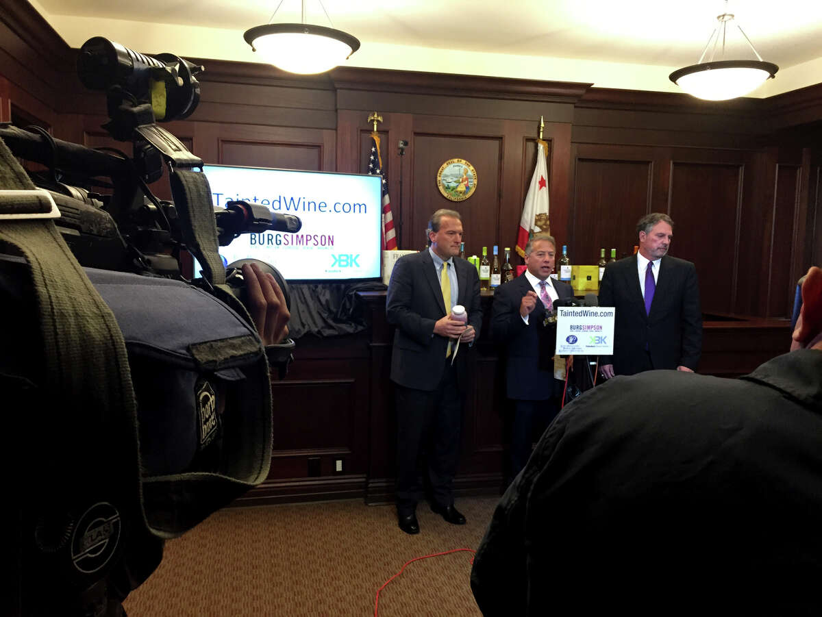 Attorneys David K. TeSelle (left), Brian S. Kabateck and Michael S. Burg announce the filing of the lawsuit in Los Angeles, alleging that many popular, low-priced wines contain dangerously high levels of arsenic.