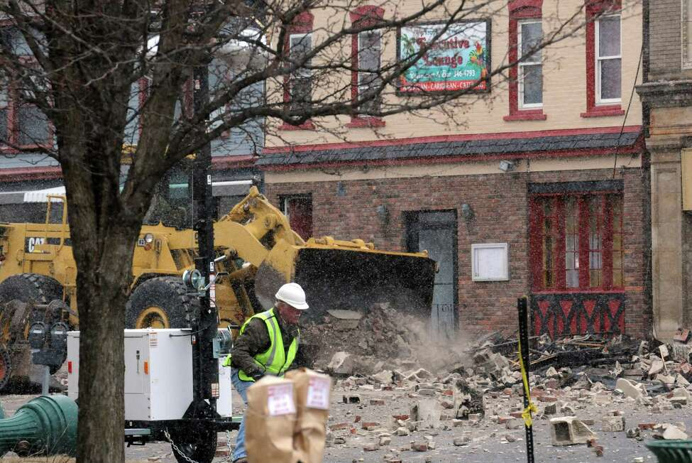 Demolition begins on the two Jay Street buildings destroyed by fire on Friday March 20, 2015 in Schenectady, N.Y. (Michael P. Farrell/Times Union)