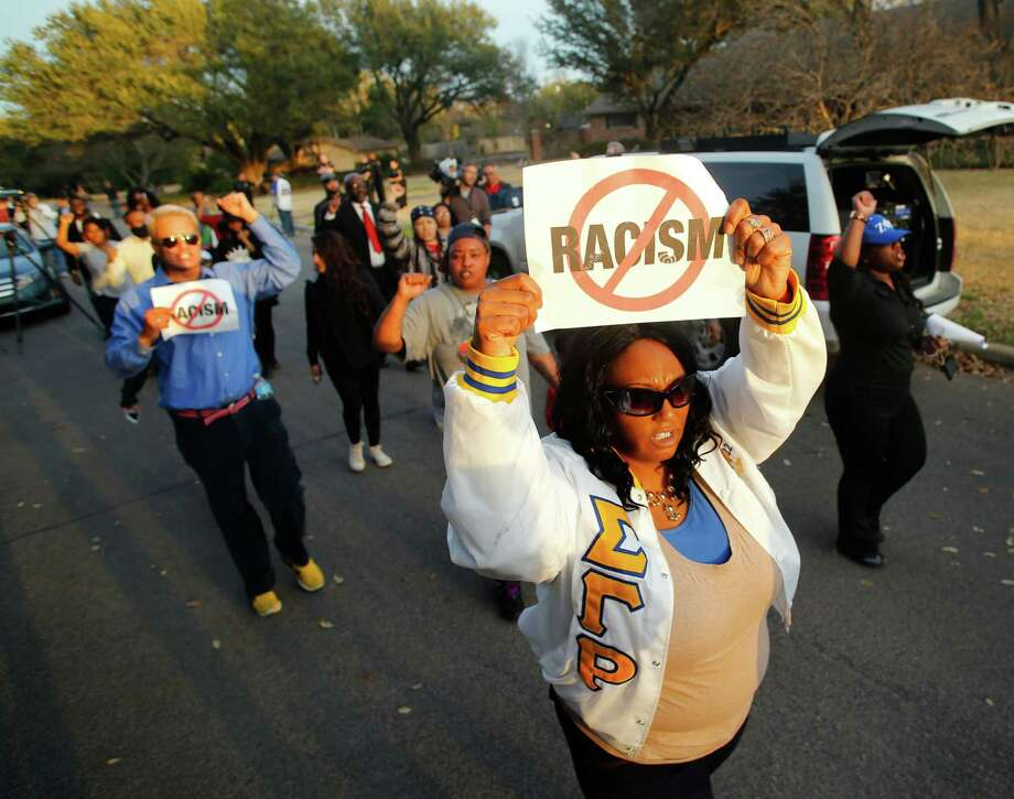 Protesters demonstrate outside the home of Parker Rice, a University of Oklahoma student caught on video in a racist fraternity chant. A reader says it is unfair to brand an entire institution for the transgressions of some fraternity members. Photo: Nathan Hunsinger /Associated Press / The Dallas Morning News
