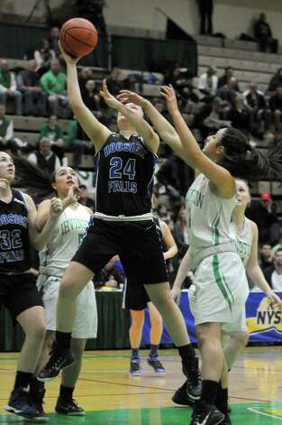 Hoosick Falls Kelly Pine drives to the basket during their 55-36 win over  Irvington in the Class B State Girls' Basketball Semifinals at HVCC on Friday March 20, 2015 in Troy, N.Y. (Michael P. Farrell/Times Union) Photo: Michael P. Farrell / 10031104A
