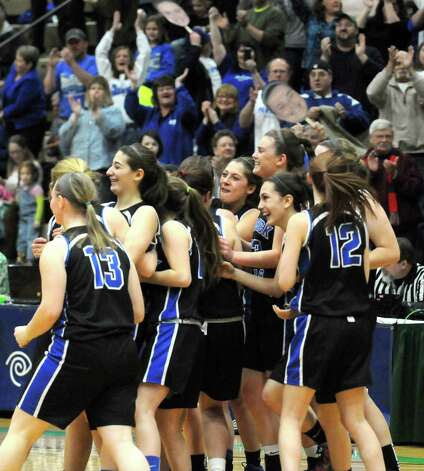 The Hoosick Falls team celebrates after defeating Irvington 55-36 in the Class B State Girls' Basketball Semifinals at HVCC on Friday March 20, 2015 in Troy, N.Y. (Michael P. Farrell/Times Union) Photo: Michael P. Farrell / 10031104A