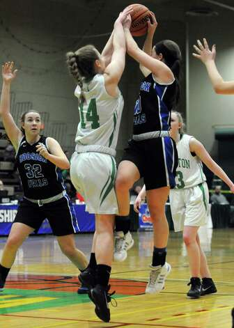 Hoosick Falls Rachel Pine looks to pass to teammate Megan Flynn during their 55-36 win over  Irvington in the Class B State Girls' Basketball Semifinals at HVCC on Friday March 20, 2015 in Troy, N.Y. (Michael P. Farrell/Times Union) Photo: Michael P. Farrell / 10031104A