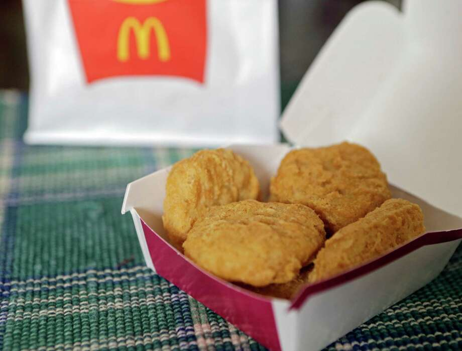 McDonald's says it plans to start using chicken raised without antibiotics important to human medicine. Consumers should welcome the move which will preserve the usefulness of antibiotics. Photo: Mark Duncan /Associated Press / AP