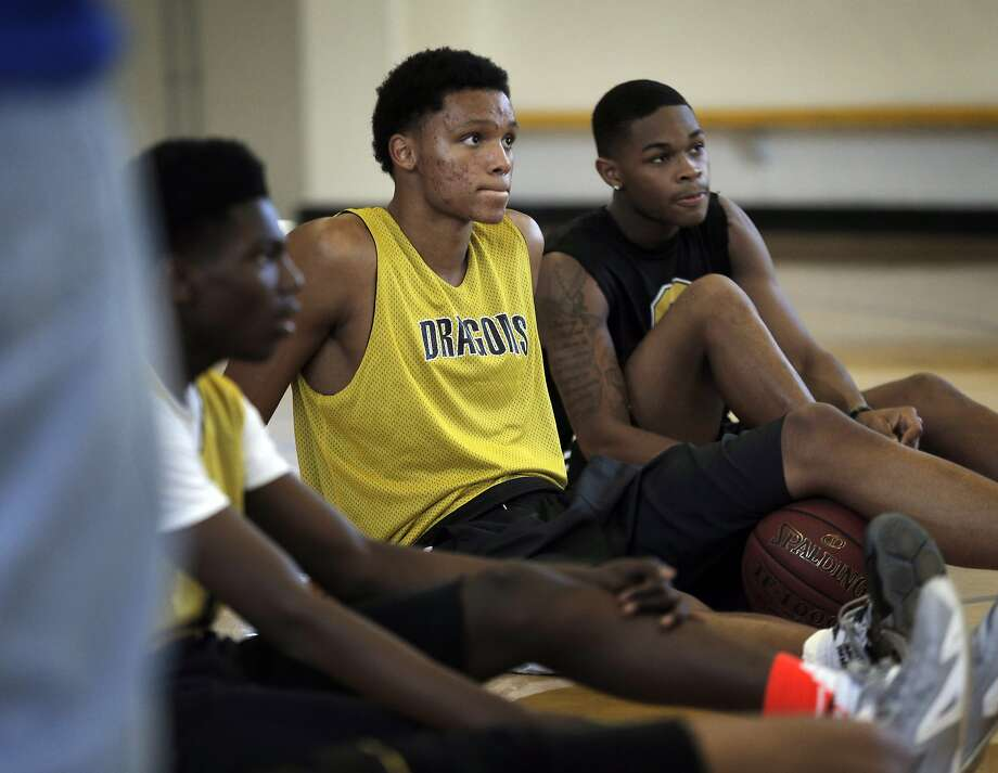 Bishop O'Dowd basketball phenoms, Ivan Rabb, left and Paris Austin, right, stretching at the school's gym in Oakland, Calif., on Thursday, March 19, 2015. The seniors once played for the same middle school team, with two Bishop O'Dowd girls basketball stars and all will be playing college ball. The girls, Asha Thomas and Aisia Robertson, were so good that they were starters with the Rabb and Austin for the Montera Middle School 8th grade boys basketball team. Photo: Carlos Avila Gonzalez, The Chronicle