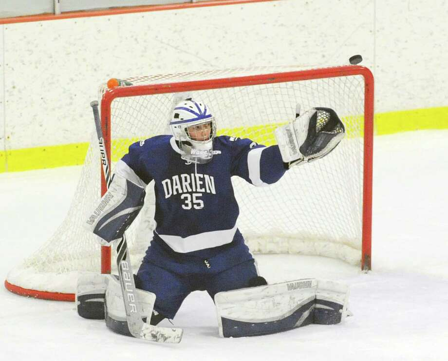 Darien goalie Will Massie. The FCIAC boys hockey championship game between Greenwich High School and Darien High School at Terry Conners Rink in Stamford, Conn., Saturday, March 7, 2015. Darien took the championship with a 5-3 victory. Photo: Bob Luckey / Greenwich Time