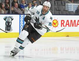 "Sharks general manager Doug Wilson said the ""C"" was taken away from Joe Thornton (pictured) because the pressure and stress got to the player, but the player said the GM should ""shut his mouth."""