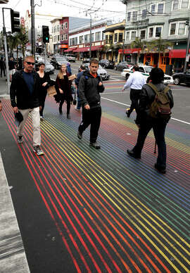 The corner of 18th and Castro streets, with its rainbow-striped crosswalks, remains the epicenter of San Francisco's highly visible lesbian, gay, bisexual and transgender community.