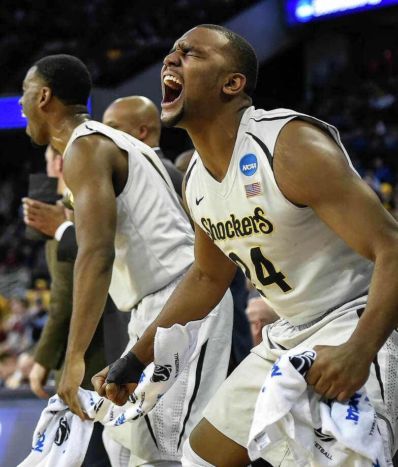 Shaquille Morris leads the cheers from the Wichita State bench against Indiana. Photo: David Eulitt / McClatchy-Tribune News Service / Kansas City Star