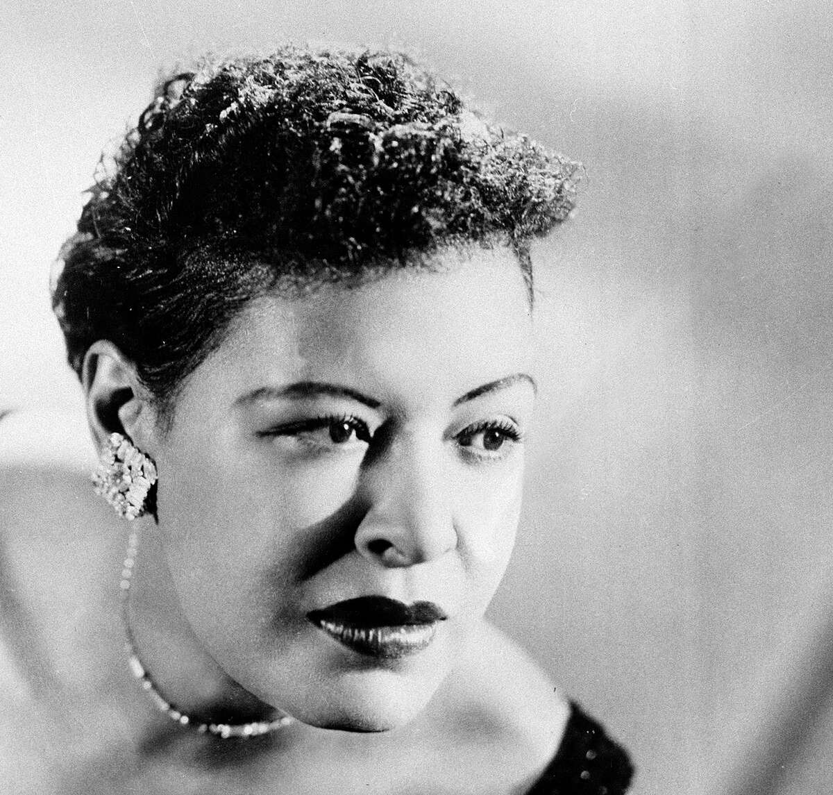 FILE - This Sept. 1958 file photo shows Billie Holiday. The Apollo Theater is planning events to commemorate the 100th birthday of Holiday. The legendary American jazz vocalist was born on April 17, 1915 and died in 1959 at the age of 44. Holiday performed at least two dozen times at the Apollo. She will be inducted into its Walk of Fame on April 16, 2015. (AP Photo/FILE)